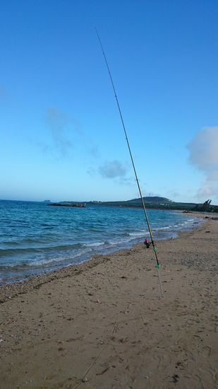 ご近所さん、ビーチで釣りです
